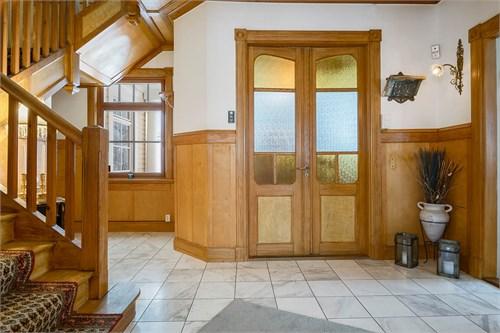 Hall, entréplan, Carraramarmor & paneler i ädelträ